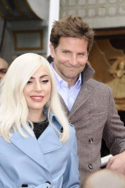 Lady Gaga, Bradley Cooper at the induction ceremony for Sam Elliott Handprint & Footprint Ceremony, TCL Chinese Theatre (formerly Grauman''s), Los Angeles, CA January 7, 2019. Photo By: Michael Germana/Everett Collection