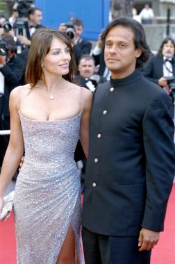 Elizabeth Hurley and Arun Nayar at the Cannes Film Festival, 5/2003, by Thierry Carpico.