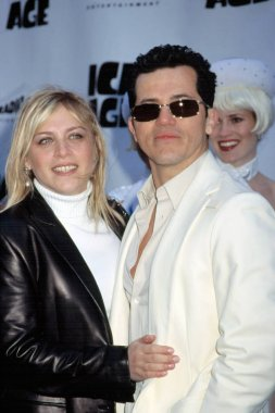 John Leguizamo and Justine Moore at premiere of ICE AGE, NY 3/10/2002, by CJ Contino