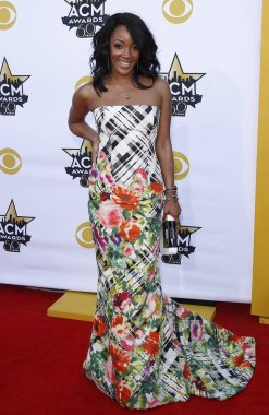 Mickey Guyton (wearing an Oscar de la Renta dress) at arrivals for 50th Academy of Country Music (ACM) Awards 2015 - Part 3, Arlington Convention Center, Arlington, TX April 19, 2015. Photo By: MORA/Everett Collection