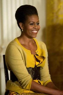 Michelle Obama (wearing a J. Crew cardigan and blouse) at a public appearance for White House Event on the Difficulties Older Women Face in the Health Insurance Market, the White House, Washington, DC November 13, 2009. Photo By: Stephen Boitano/Ever