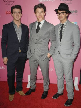 Kevin Jonas, Nick Jonas, Joe Jonas at arrivals for 12th Annual Young Hollywood Awards, Wilshire Ebell Theatre, Los Angeles, CA May 13, 2010. Photo By: Dee Cercone/Everett Collection