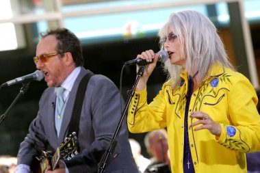 Elvis Costello, Emmylou Harris on stage for NBC Today Show Concert Series with Elvis Costello, Rockefeller Center, New York, NY, July 22, 2005. Photo by: Gregorio Binuya/Everett Collection