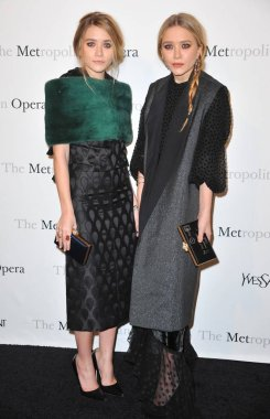Ashley Olsen (L), Mary-Kate Olsen (both wearing Yves Saint Laurent) in attendance for The Metropolitan Opera Premiere of LE COMTE ORY, Lincoln Center, New York, NY March 24, 2011. Photo By: Gregorio T. Binuya/Everett Collection