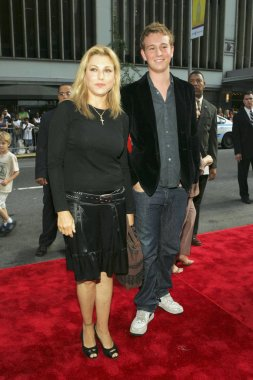 Tatum O'Neal, son Kevin McEnroe at arrivals for THE BAD NEWS BEARS World Premiere, The Ziegfeld Theatre, New York, NY, July 18, 2005. Photo by: Gregorio Binuya/Everett Collection