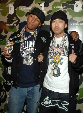 Pharrell Williams , Nigo at arrivals for A Bathing Ape One Year Anniversary Party, Marquee nightclub, New York, NY, Wednesday, January 25, 2006. Photo by: Brad Barket/Everett Collection