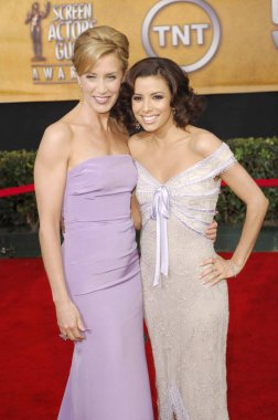 Felicity Huffman (wearing Nicole Miller), Eva Longoria (wearing Badgley Mischka) at arrivals for 12th Annual Screen Actors Guild SAG Awards, The Shrine Auditorium, Los Angeles, CA, January 29, 2006. Photo by: Michael Germana/Everett Collection