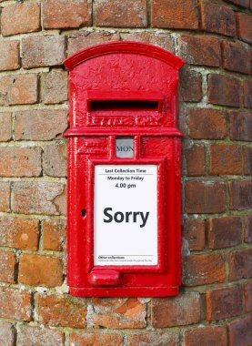 British post box with a message that reads Sorry, ideal for a greeting card design