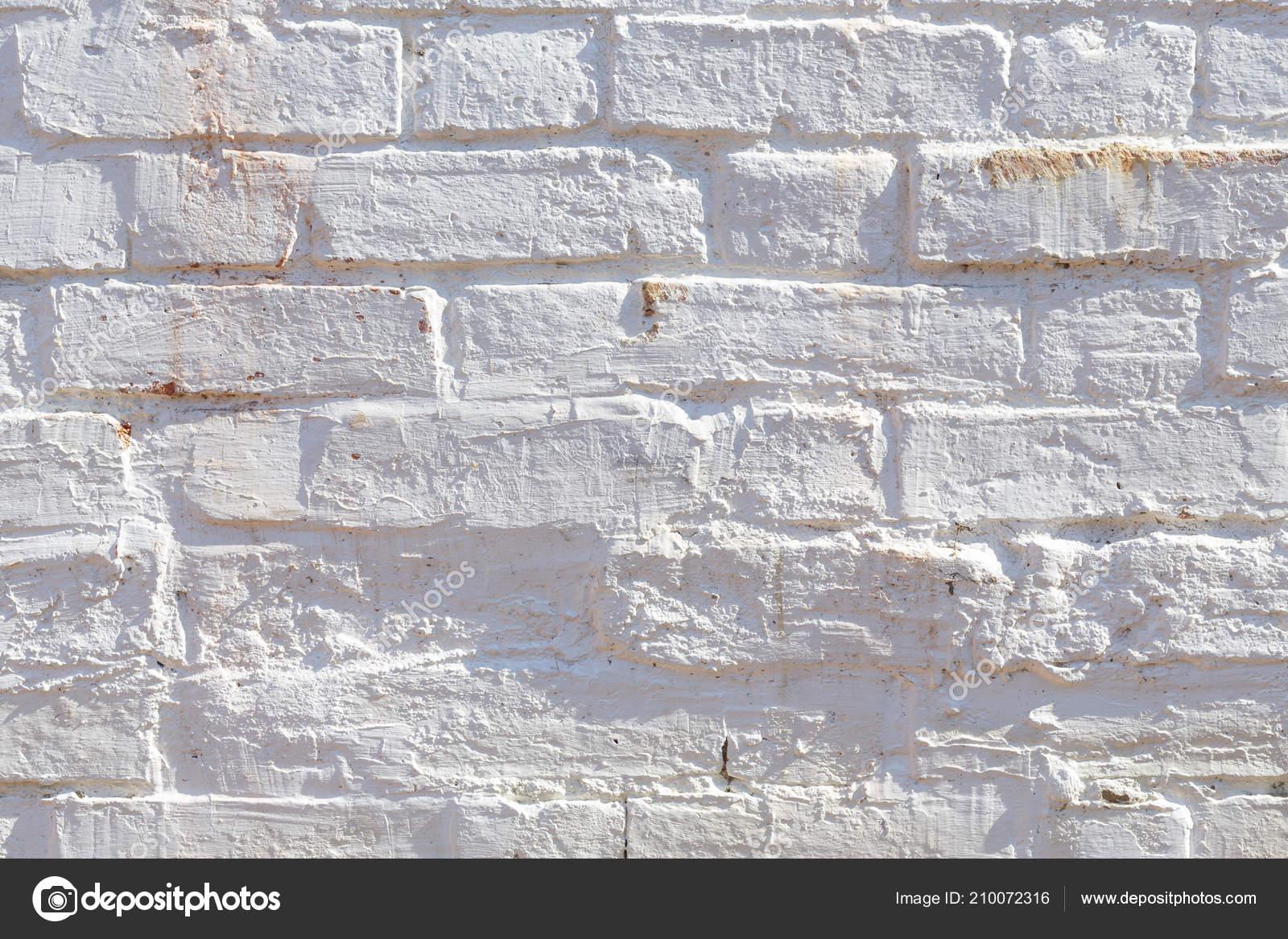 Stenen Muur Wit : Detail van oude bakstenen muur geschilderd wit noodlijdende