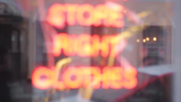shop signboard clothes neon text