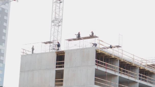 high-rise stavitelé stavět místo překrývající se kolektivní stavebnictví profesionální jeřáb
