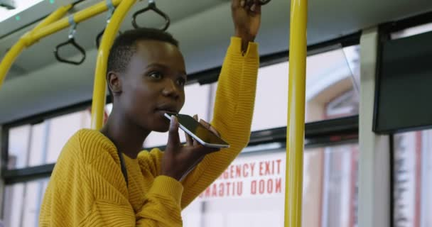 Young woman talking on mobile phone while travelling in bus 4k
