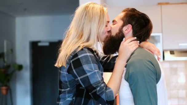 Romantic couple kissing in kitchen at home 4k