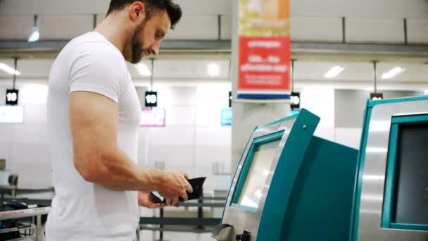 Commuter scanning passport on scanner machine at airport terminal 4k