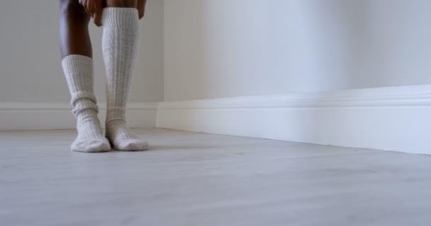 Low section of woman wearing socks in fitness studio 4k