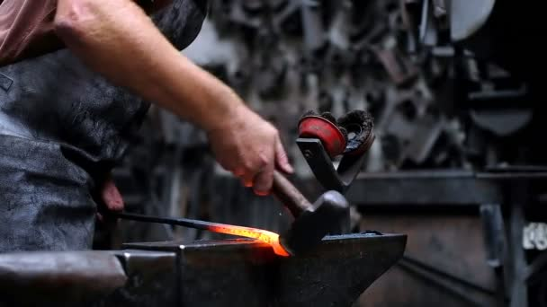 Blacksmith shaping the molten metal with hammer 4k
