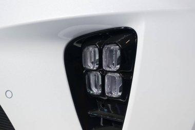 Close up KIA logo. New KIA Sorento car details at motor show, Automobile Salon, selective focus