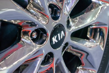 Close up KIA logo on wheel rim. New KIA Sorento car details at motor show, Automobile Salon, selective focus