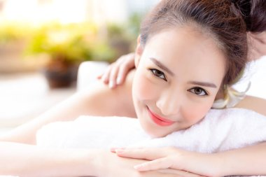 Portrait relaxed beautiful woman. Charming beautiful woman feel relaxed, happy with smiley face. Attractive beautiful girl love massage, aromatherapy at spa shop. Gorgeous woman has good mood