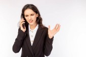 Üzletasszony lesz nem ért egyet, dühös, elégedetlen és boldogtalan ügyfele vagy főnöke. Fehér galléros munkás beszél az ügyfelével, főnök mobiltelefonnal. Üzletasszony kap érvek, frusztrált