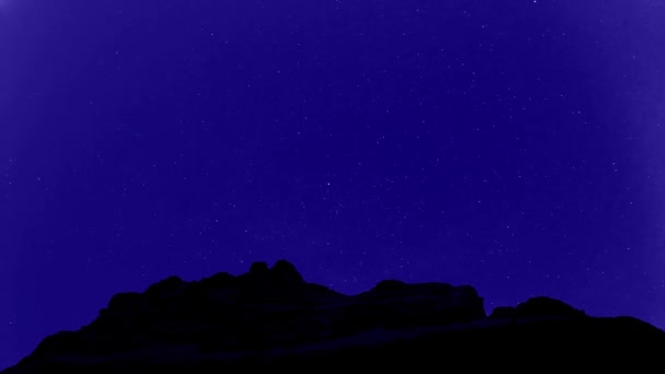 Timelapse of stars moving in night sky over Mountains, full HD video