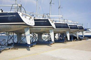 Luxury yachts at shipyard waiting for maintenance and repai