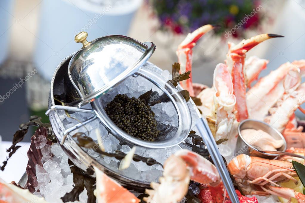 Black caviar served with seafood