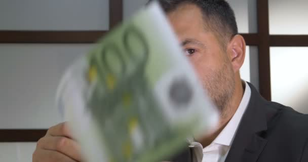 Happy man with money. Business man scattering money