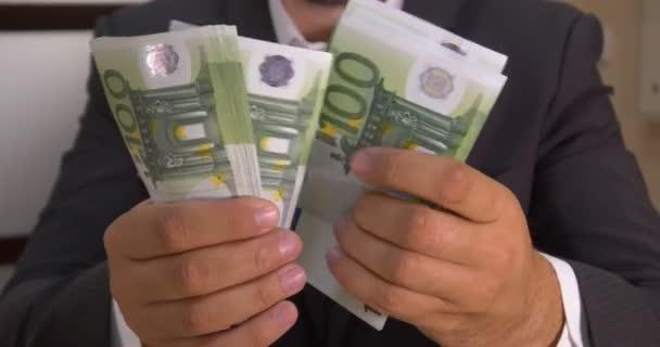 Successful businessman counts money