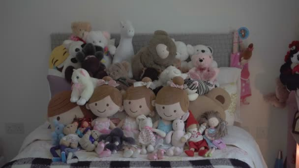 Toys lie on bed in childrens room