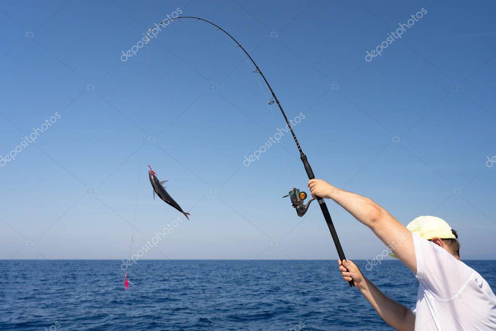 Fishermen fishing from boat in sea