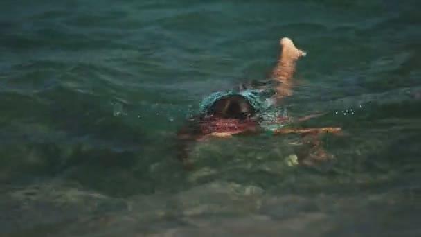 8-10 years girls swimming in the sea