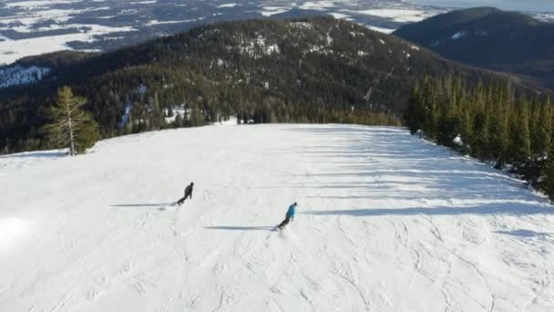 Two Snowboarding People Drone Aerial Follow Behind Amazing Birds Eye View Snowboard Extreme Winter Sport Downhill Ski Slope
