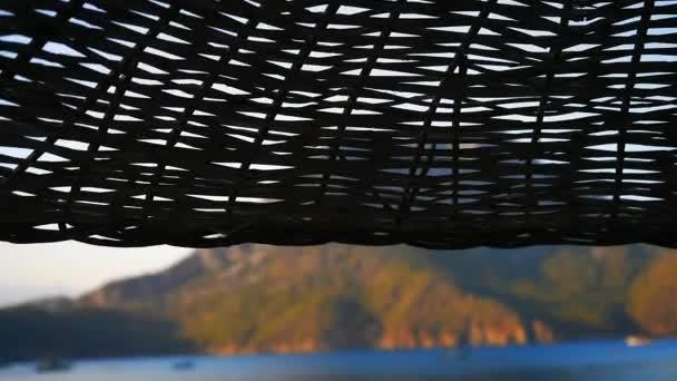 Beautiful sea view through the beach umbrella