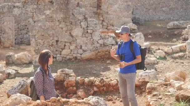 Two young archaeologists exploring ancient city