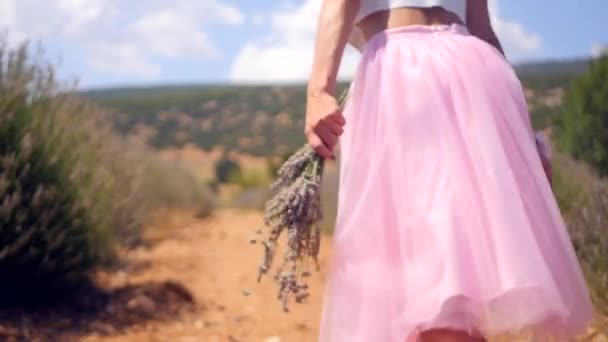 Womans hand holding lavender flowers and runs