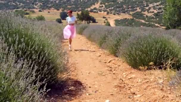 Woman jumping in the lavender field
