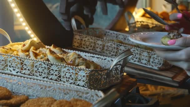 Food buffet in a luxury hotel. Taking cookies