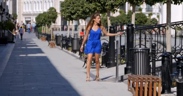Young woman walking down the street