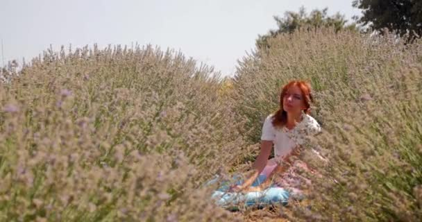 young woman waking up in the lavanda field
