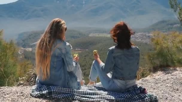 Young women at viewpoint enjoying beautiful landscape