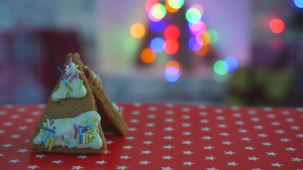 Hand-made eatable gingerbread house, snow decoration, garland background illumination