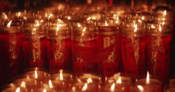 A closeup shot of flame on candle with chinese character mean ushering in wealth and prosperity