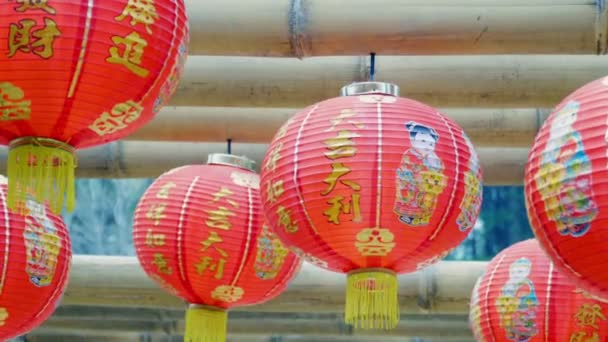 Chinese new year lanterns hanging on bamboo wood ,blessing text mean have wealth and happy