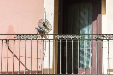 view of sun lighted balcony with ventilator