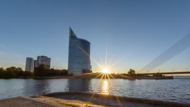 Timelapse of sunset with business building bank skyscraper in Riga city downtown