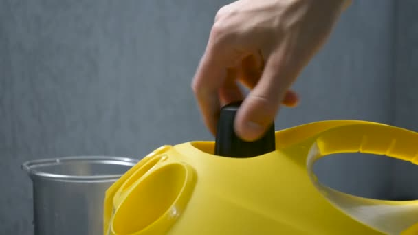 Opening of a sealed boiler water cap steam cleaner hand closeup