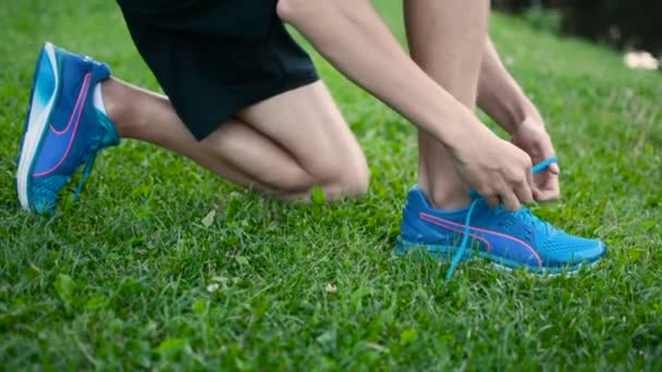 Tying shoelaces in preparation for jogging session or marathon cross run