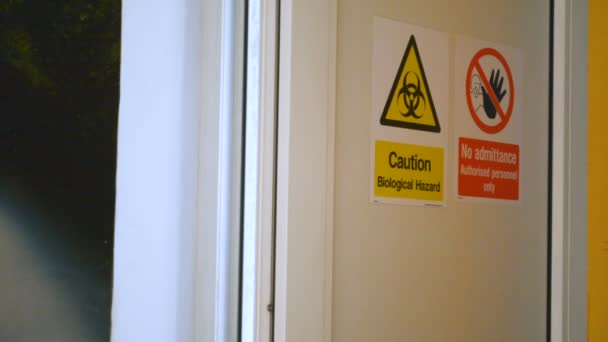 Man enters dangerous secret biological laboratory, door closes behind him