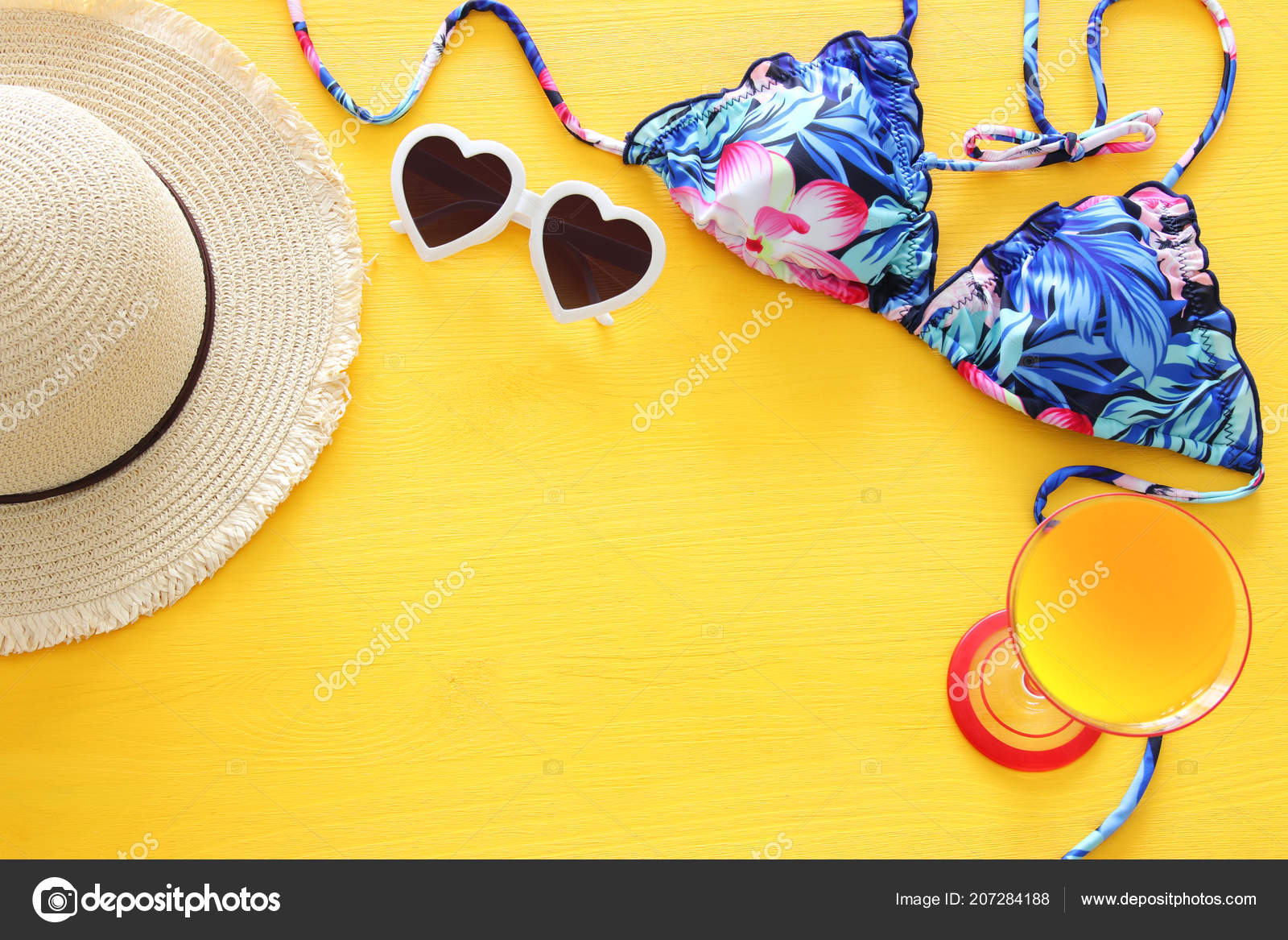 550c5d3ba0 Top view of fashion female swimsuit bikini and white fedora hat over yellow wooden  background. Summer beach vacation concept — Photo by ...
